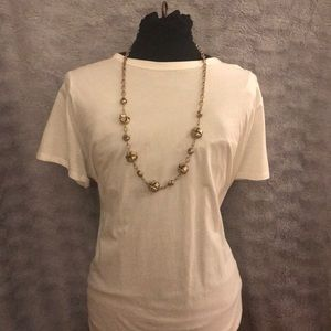 Gold tone knot necklace.